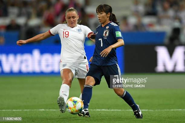 England's midfielder Georgia Stanway vies for the ball with Japan's midfielder Emi Nakajima during the France 2019 Women's World Cup Group D football...