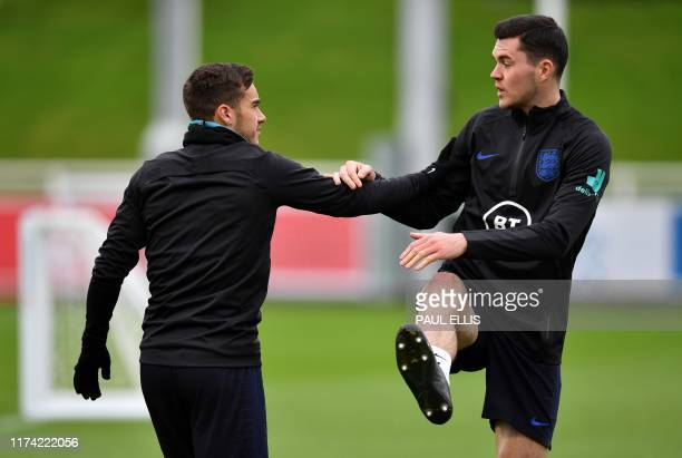 England's midfielder Harry Winks and England's defender Michael Keane attends an England team training session at St George's Park in BurtononTrent...