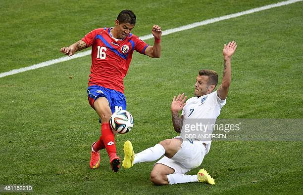 England's midfielder Jack Wilshere challengesCosta Rica's defender Cristian Gamboa for the ball during the Group D football match between Costa Rica...