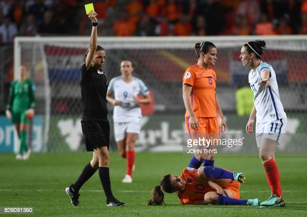England's midfielder Jade Moore receives a yellow card from French referee Stephanie Frappart as Netherlands' midfielder Danielle van de Donk reacts...