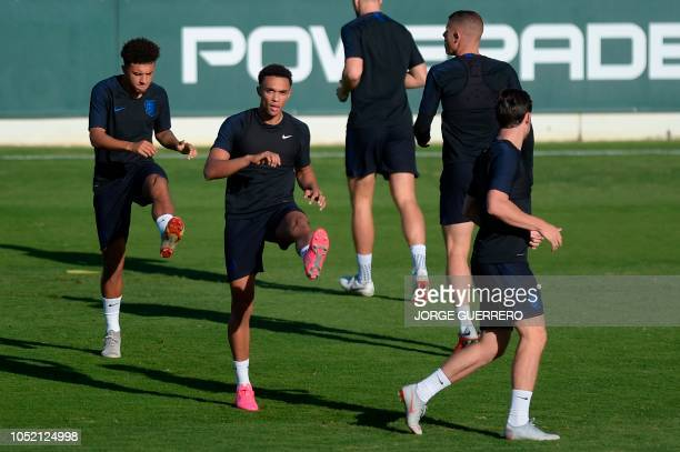 England's midfielder Jadon Sancho and England's defender Trent AlexanderArnold take part in a training session at the Ciudad Deportiva Luis del Sol...