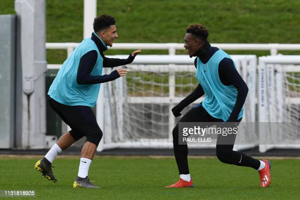 England's midfielder Jadon Sancho and England's midfielder Callum HudsonOdoi attend an England team training session at St George's Park in...