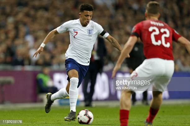 England's midfielder Jadon Sancho runs with the ball during the UEFA Euro 2020 Group A qualification football match between England and Czech...