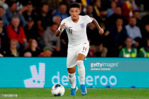 England's midfielder Jadon Sancho runs with the ball during the UEFA Euro 2020 qualifying Group A football match between England and Kosovo at St...