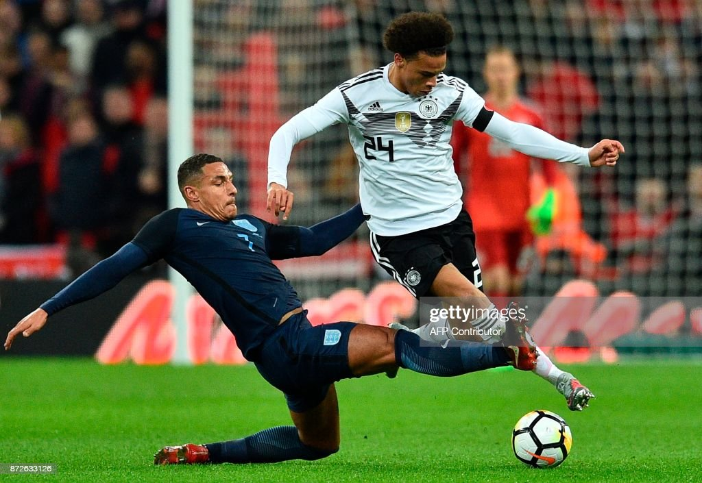 England's midfielder Jake Livermore (L) tries to tackle Germany's midfielder Leroy Sane (R) during the friendly international football match between England and Germany at Wembley Stadium in London on November 10, 2017. / AFP PHOTO / Glyn KIRK / NOT