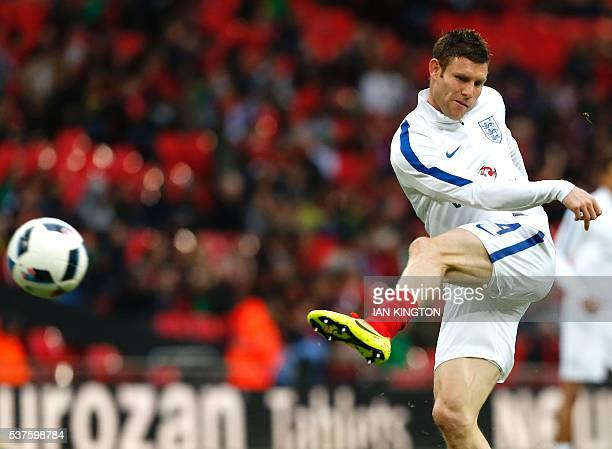 England's midfielder James Milner warms up before the friendly football match between England and Portugal at Wembley stadium in London on June 2...