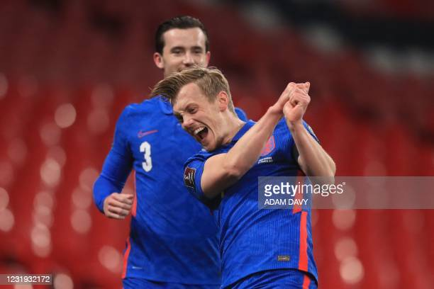 England's midfielder James Ward-Prowse celebrates scoring the opening goal during the FIFA World Cup Qatar 2022 qualification football match between...