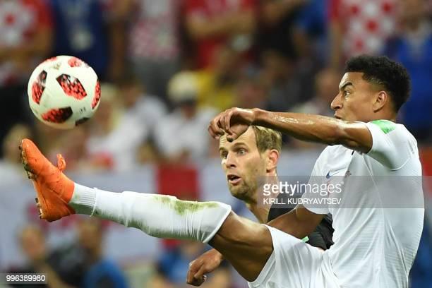 England's midfielder Jesse Lingard challenges Croatia's defender Ivan Strinic during the Russia 2018 World Cup semi-final football match between...
