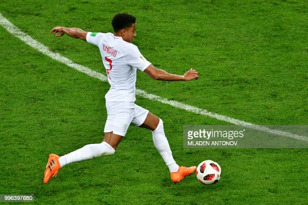 England's midfielder Jesse Lingard runs with the ball during the Russia 2018 World Cup semifinal football match between Croatia and England at the...