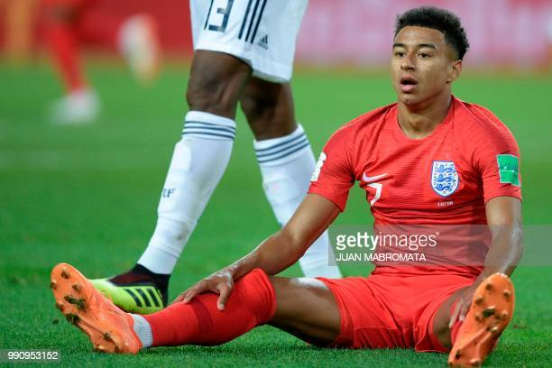 England's midfielder Jesse Lingard sits on the ground during the Russia 2018 World Cup round of 16 football match between Colombia and England at the...