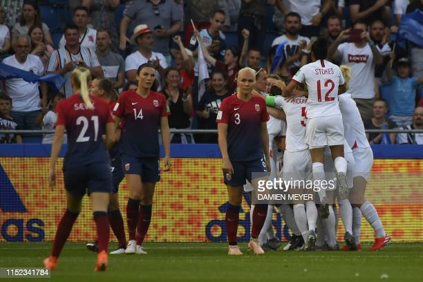 England's midfielder Jill Scott is congratulated by teammates after scoring a goal during the France 2019 Women's World Cup quarterfinal football...