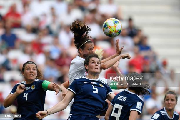 TOPSHOT England's midfielder Jill Scott jumps for the ball with Scotland's defender Jennifer Beattie during the France 2019 Women's World Cup Group D...