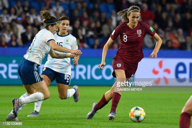 England's midfielder Jill Scott runs with the ball during the France 2019 Women's World Cup Group D football match between England and Argentina on...