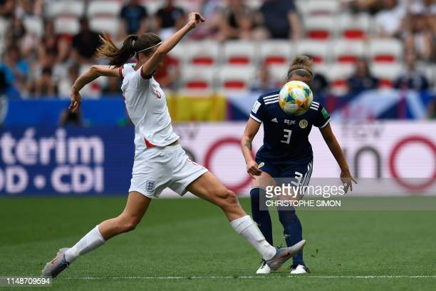 England's midfielder Jill Scott vies for the ball with Scotland's defender Nicola Docherty during the France 2019 Women's World Cup Group D football...