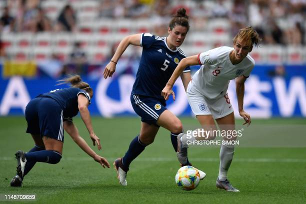 England's midfielder Jill Scott vies for the ball with Scotland's defender Jennifer Beattie during the France 2019 Women's World Cup Group D football...