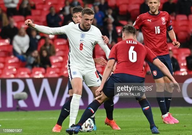 England's midfielder Jordan Henderson and Czech Republic's defender Tomas Kalas vie for the ball during the UEFA EURO 2020 Group D football match...