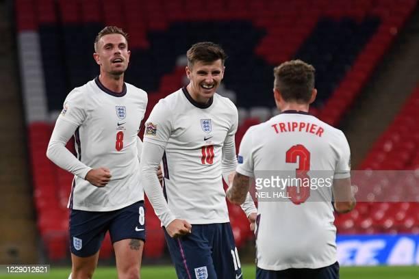 England's midfielder Jordan Henderson and England's defender Kieran Trippier congratulate goalscorer England's midfielder Mason Mount during the UEFA...