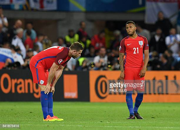England's midfielder Jordan Henderson and England's defender Ryan Bertrand react following their draw during the Euro 2016 group B football match...