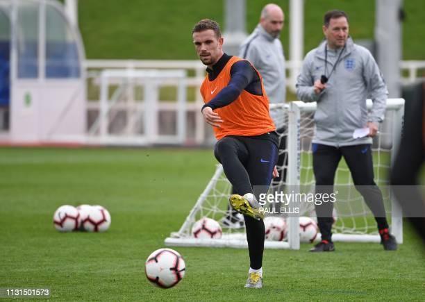 England's midfielder Jordan Henderson attends a England team training session at St George's Park in BurtononTrent central England on March 19 ahead...