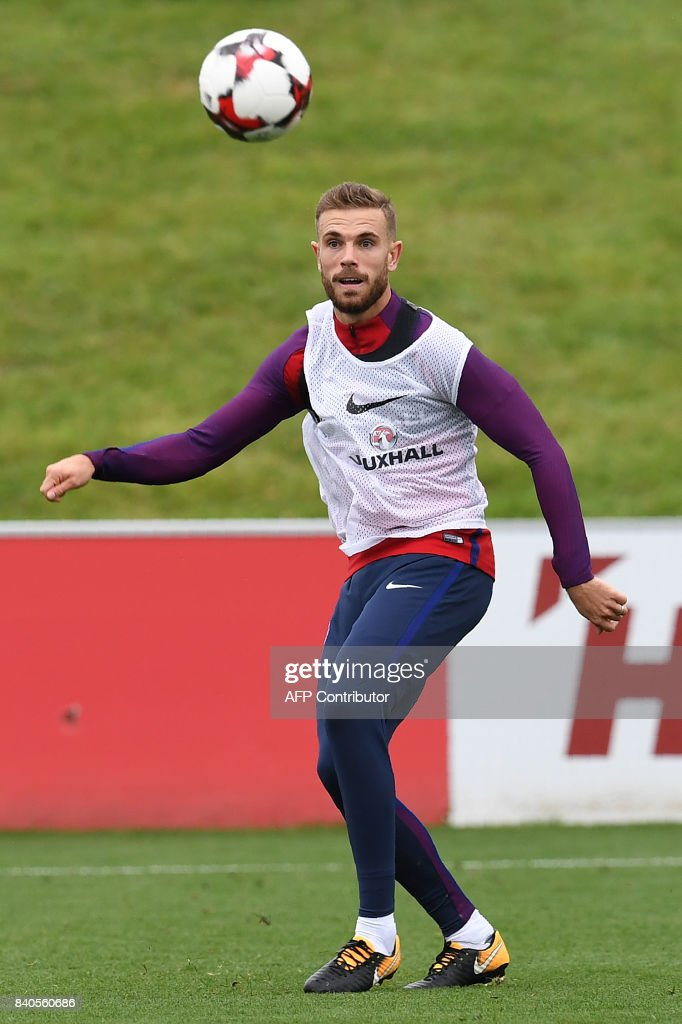 England's midfielder Jordan Henderson attends a training session at St George's Park in Burton-on-Trent on August 29, 2017, as part of an England football team media day ahead of their 2018 FIFA World Cup qualifier matches against Malta on September 1 and Slovakia on September 4. / AFP PHOTO / Paul ELLIS / NOT
