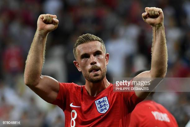 TOPSHOT England's midfielder Jordan Henderson celebrates at the end of the Russia 2018 World Cup Group G football match between Tunisia and England...