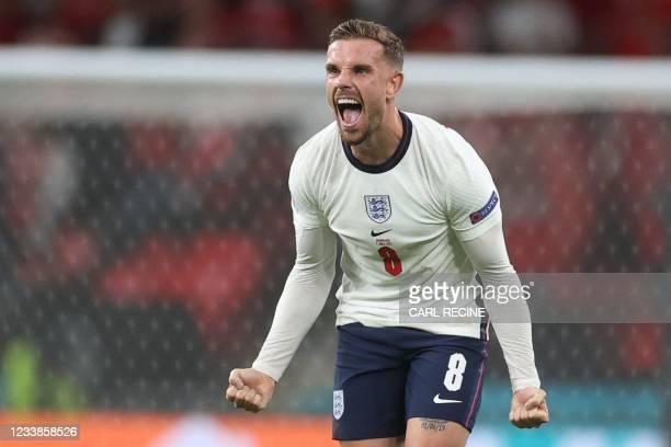 England's midfielder Jordan Henderson celebrates their win in the UEFA EURO 2020 semi-final football match between England and Denmark at Wembley...