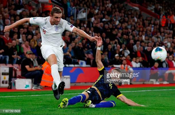 England's midfielder Jordan Henderson crosses the ball past Kosovo's midfielder Valon Berisha during the UEFA Euro 2020 qualifying Group A football...