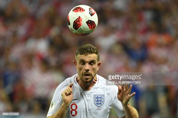 England's midfielder Jordan Henderson heads the ball during the Russia 2018 World Cup semi-final football match between Croatia and England at the...