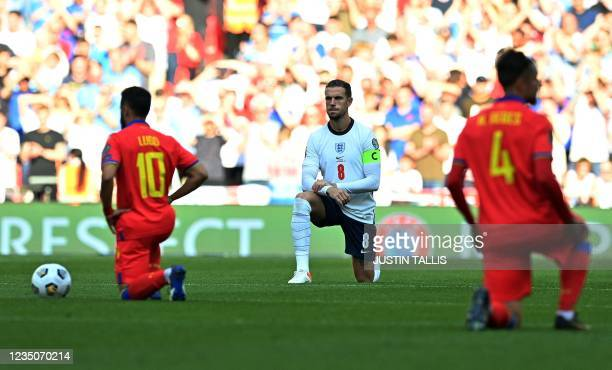 England's midfielder Jordan Henderson kneels in support of the Black Lives matter movement ahead of the FIFA World Cup 2022 qualifying match between...