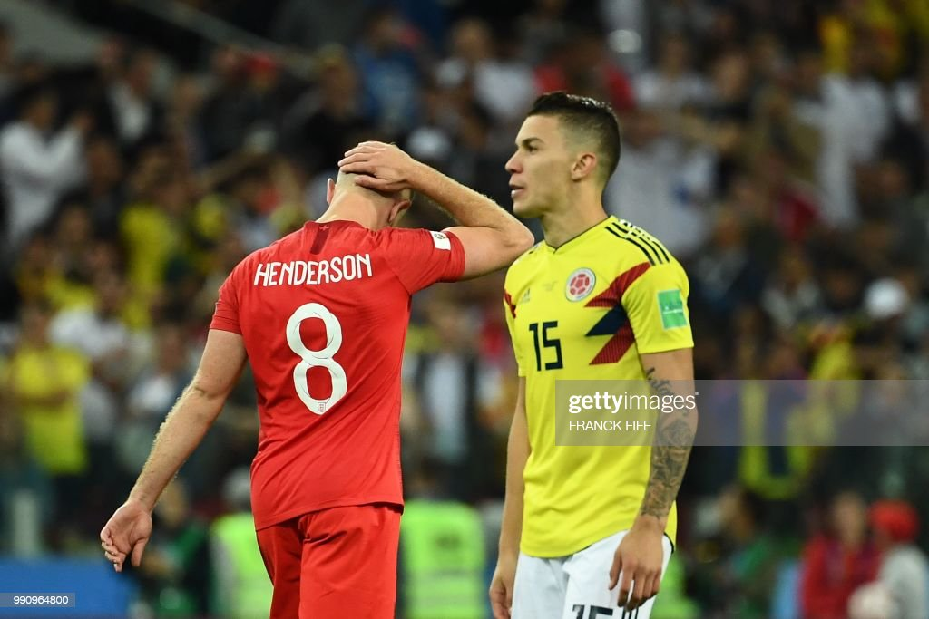 England's midfielder Jordan Henderson (L) reacts after missing a penalty as Colombia's midfielder Mateus Uribe (R) prepares for his penalty kick during the penalty shoot-out of the Russia 2018 World Cup round of 16 football match between Colombia and England at the Spartak Stadium in Moscow on July 3, 2018. (Photo by FRANCK FIFE / AFP) / RESTRICTED