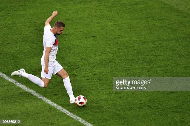 England's midfielder Jordan Henderson warms up prior to the Russia 2018 World Cup semifinal football match between Croatia and England at the...