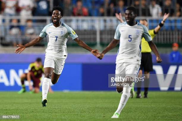 England's midfielder Joshua Onomah celebrates their victory during the U20 World Cup final football match between England and Venezuela in Suwon on...