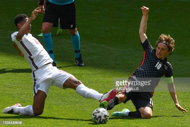 England's midfielder Jude Bellingham and Croatia's midfielder Luka Modric vie for the ball during the UEFA EURO 2020 Group D football match between...