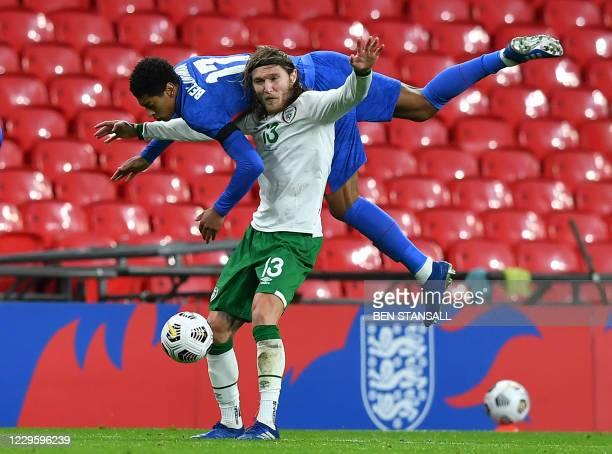 England's midfielder Jude Bellingham and Republic of Ireland's midfielder Jeff Hendrick vie for the ball during the international friendly football...
