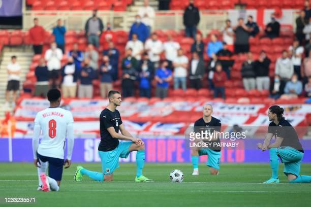 England's midfielder Jude Bellingham , Austria's defender Stefan Posch , Austria's midfielder Xaver Schlager and Austria's striker Marcel Sabitzer...