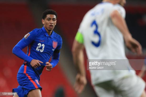 England's midfielder Jude Bellingham plays during the FIFA World Cup Qatar 2022 qualification football match between England and San Marino at...