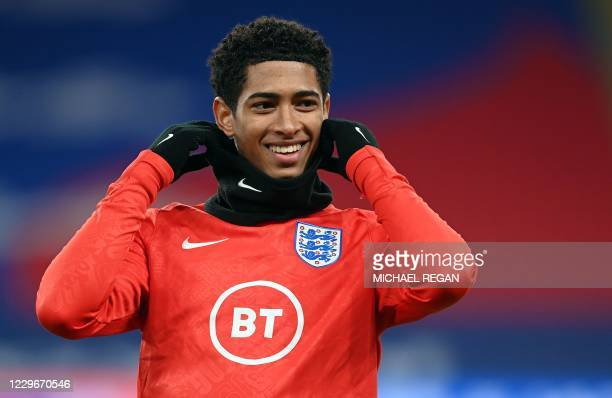 England's midfielder Jude Bellingham warms up for the UEFA Nations League group A2 football match between England and Iceland at Wembley stadium in...