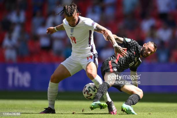 England's midfielder Kalvin Phillips and Croatia's midfielder Marcelo Brozovic vie for the ball during the UEFA EURO 2020 Group D football match...