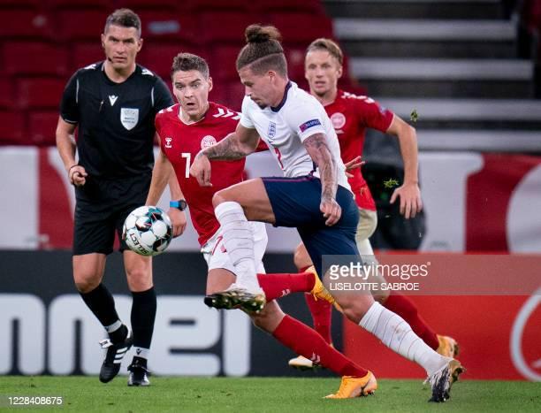 England's midfielder Kalvin Phillips and Denmark's midfielder Robert Skov vie for the ball during the UEFA Nations League football match between...