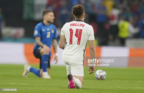 England's midfielder Kalvin Phillips takes a knee before the start of the UEFA EURO 2020 final football match between Italy and England at the...