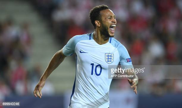 England's midfielder Lewis Baker celebtates scoring a penalty during the UEFA U21 European Championship Group A football match England v Poland in...