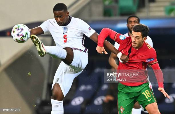 England's midfielder Marc Guehi fights for the ball with Portugal midfielder Pedro Pote Goncalves during the 2021 UEFA European Under-21 Championship...