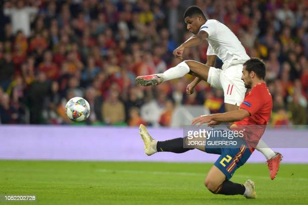 England's midfielder Marcus Rashford vies with Spain's defender Jonny during the UEFA Nations League football match between Spain and England on...