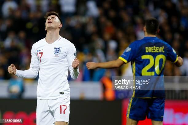England's midfielder Mason Mount celebrates after scoring a goal next to Kosovo's defender Ibrahim Dresevic during the UEFA Euro 2020 qualifying...