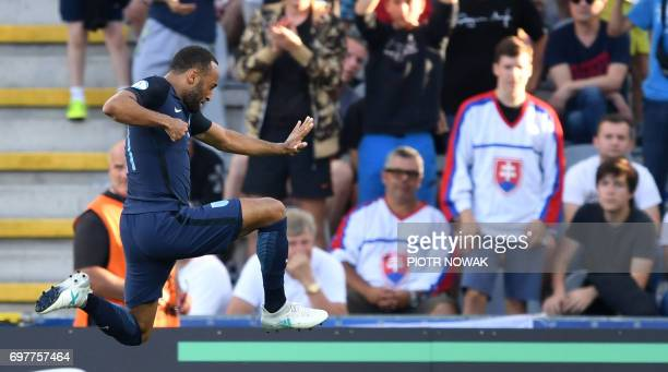 England's midfielder Nathan Redmond celebrates scoring his side second goal during the UEFA U21 European Championship Group A football match Slovakia...