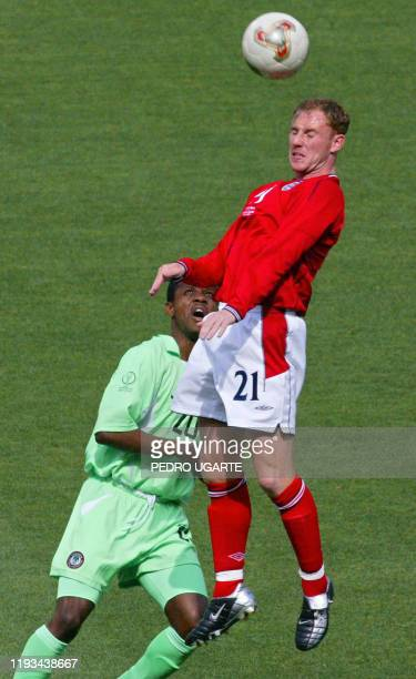England's midfielder Nicky Butt heads the ball above Nigeria's midfielder James Obiorah during match 38 group F of the 2002 FIFA World Cup Korea...