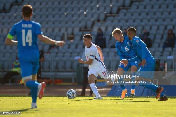 England's midfielder Phil Foden and Iceland's midfielder Jon Dagur Thorsteinsson vie for the ball during the UEFA Nations League football match...
