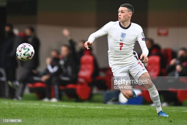 England's midfielder Phil Foden looks at the ball during the FIFA World Cup Qatar 2022 qualification Group I football match between Albania and...