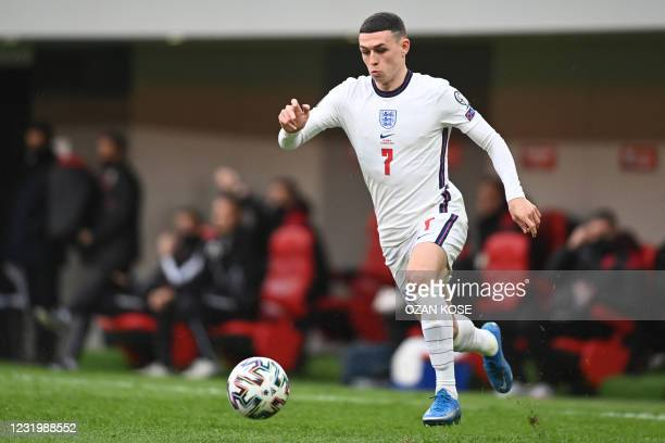 England's midfielder Phil Foden runs with the ball during the FIFA World Cup Qatar 2022 qualification Group I football match between Albania and...