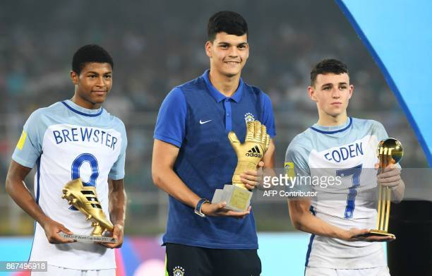 England's midfielder Phil Foden with his 'Man of the Tournament' trophy England's forward Rhin Brewster with his 'Highest Scorer' trophy and...